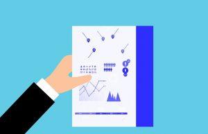 Analytics Paper Hand Holding
